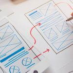 Designer creating a UX design for web app