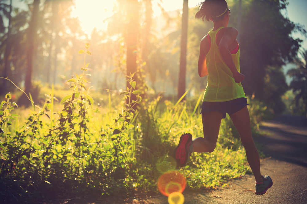 Young fitness woman running in morning